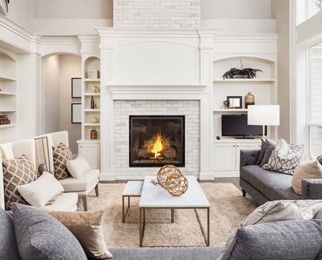 Cozy living room in white with fireplace on